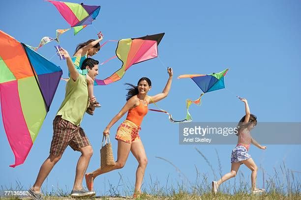 Hispanic family flying kites