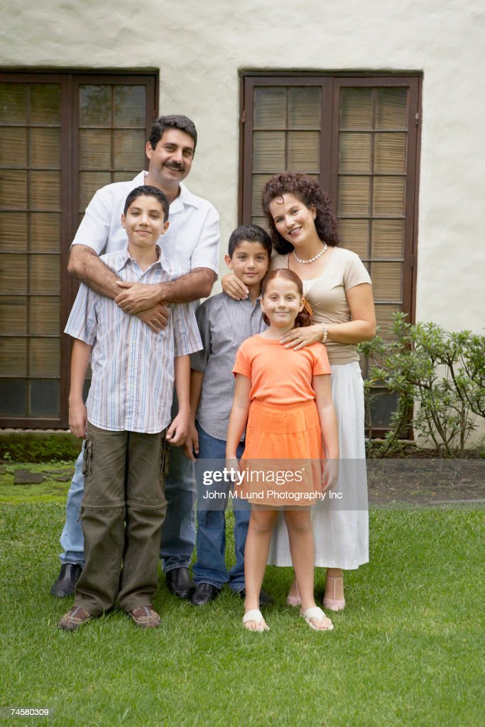 hispanic family in front of house stock photo getty images