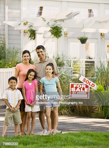 hispanic family in front of new house stock photo getty images. Black Bedroom Furniture Sets. Home Design Ideas