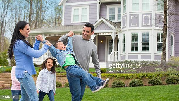 Hispanic family playing in front yard