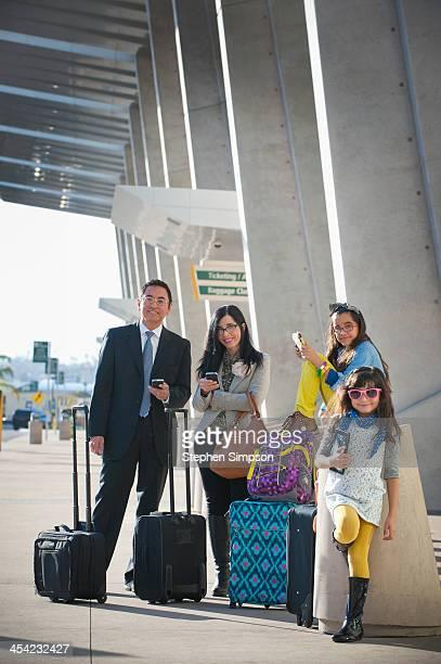 Hispanic family portrait at airport