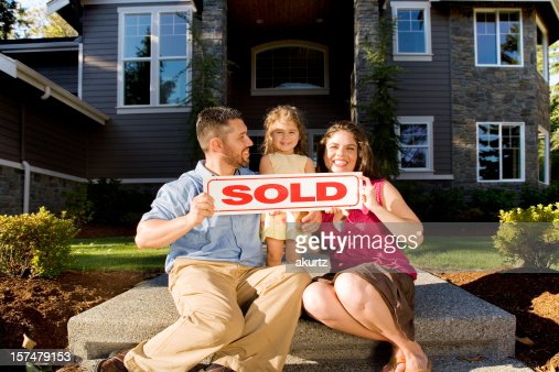 Hispanic Family purchases their new home excited happy daughter outdoors
