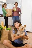 Hispanic family putting away groceries