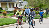 Hispanic family riding bicycles together