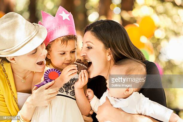 Hispanic family sharing cupcake