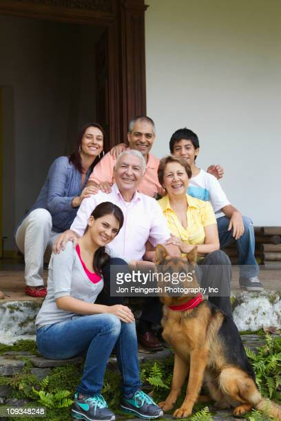 Hispanic family sitting outdoors together