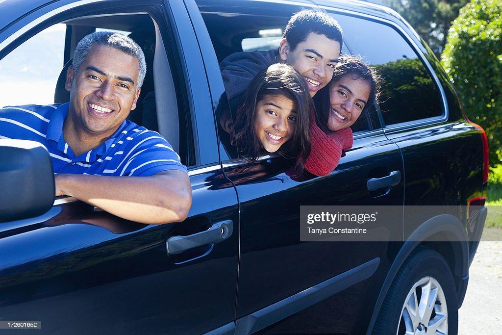 Hispanic family smiling in car : Stock Photo