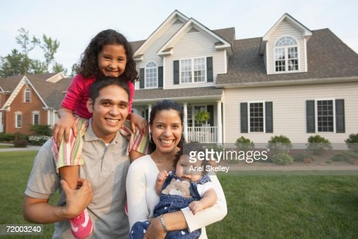 hispanic family smiling in front of house stock photo getty images. Black Bedroom Furniture Sets. Home Design Ideas