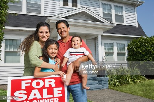 hispanic family standing next to for sale sign in front of house stock photo getty images. Black Bedroom Furniture Sets. Home Design Ideas