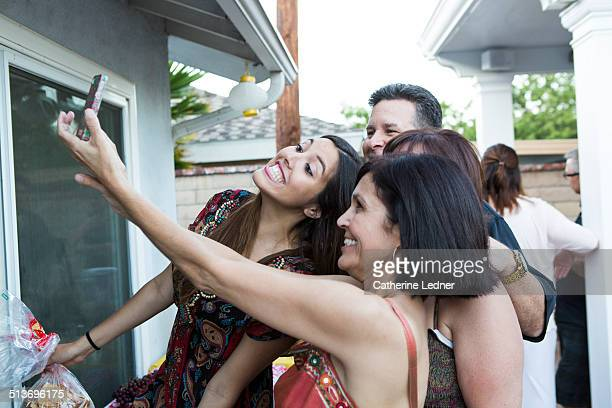 Hispanic Family taking a Selfie