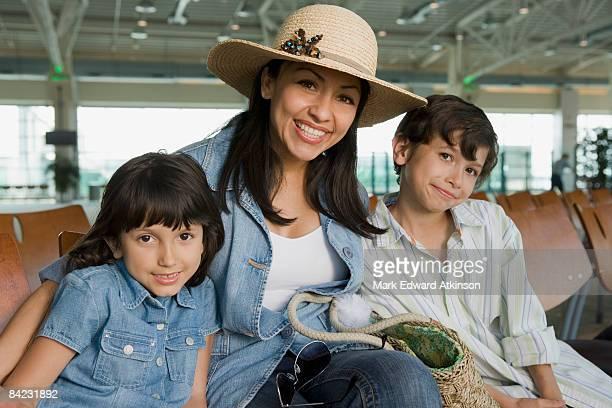 Hispanic family waiting in airport