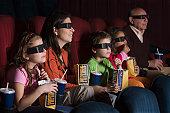 Hispanic family watching 3D movie
