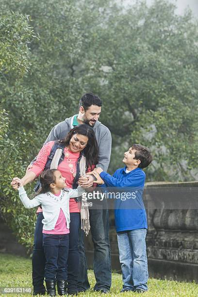 Hispanic family with two children in the park