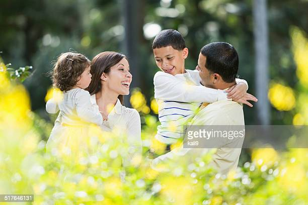 Hispanic family with two young children at park
