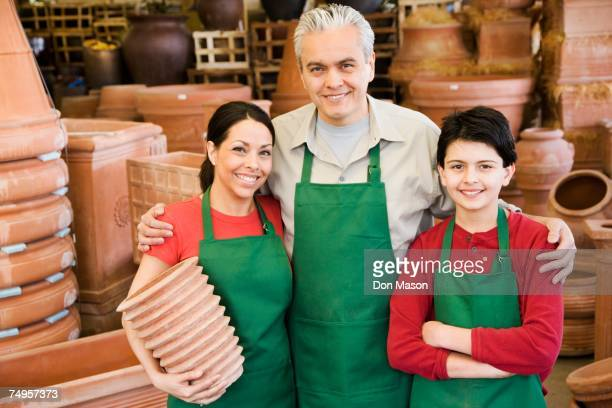 Hispanic family working at garden center