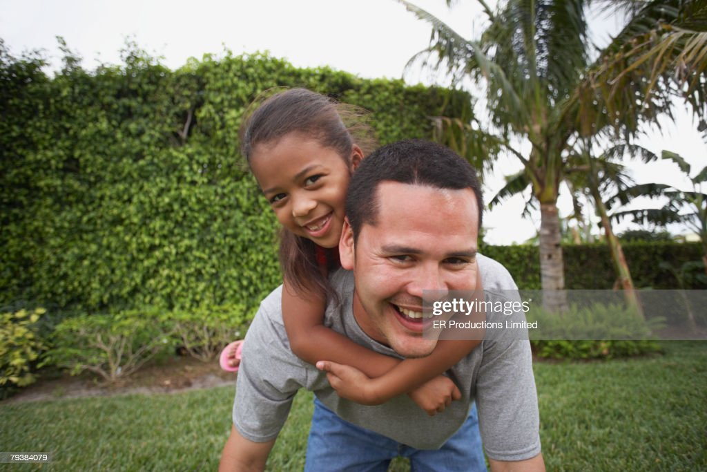Hispanic father and daughter playing : Stock Photo