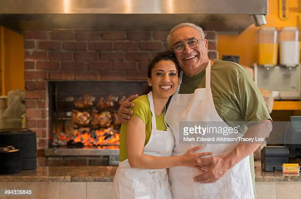 Hispanic father and daughter working in restaurant