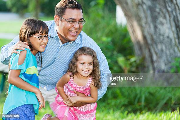 Hispanic father and daughters