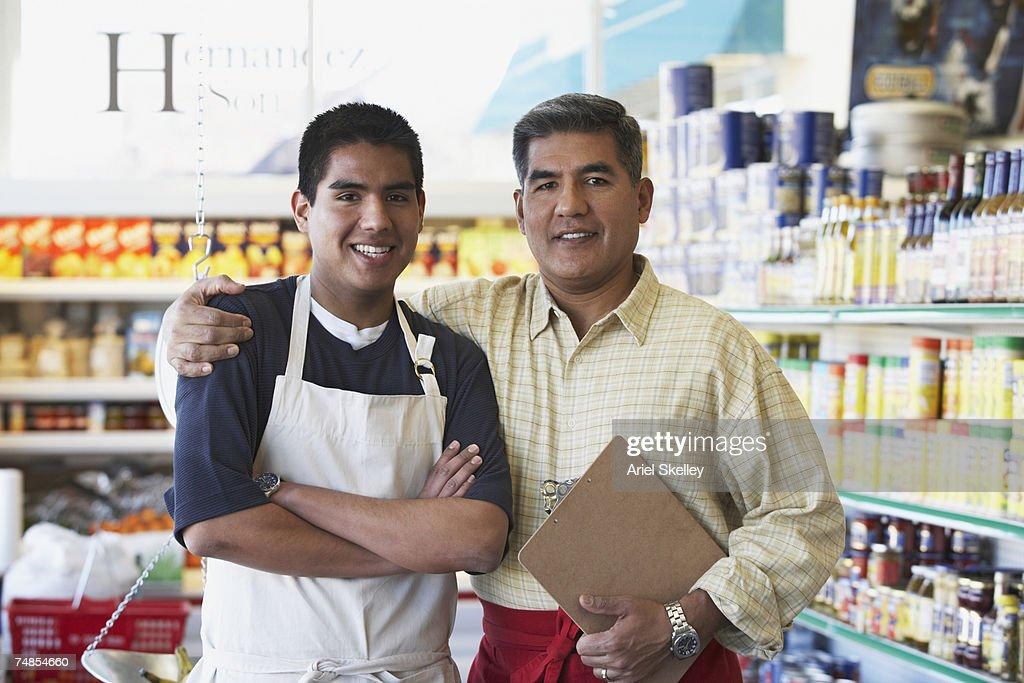 Hispanic father and son in family owned bodega : Bildbanksbilder