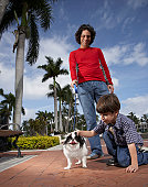 Hispanic father and son with dog