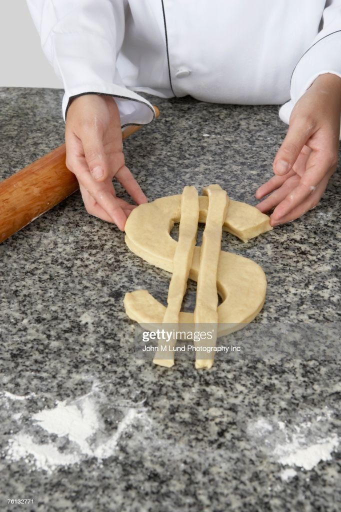 Hispanic female baker making dollar sign