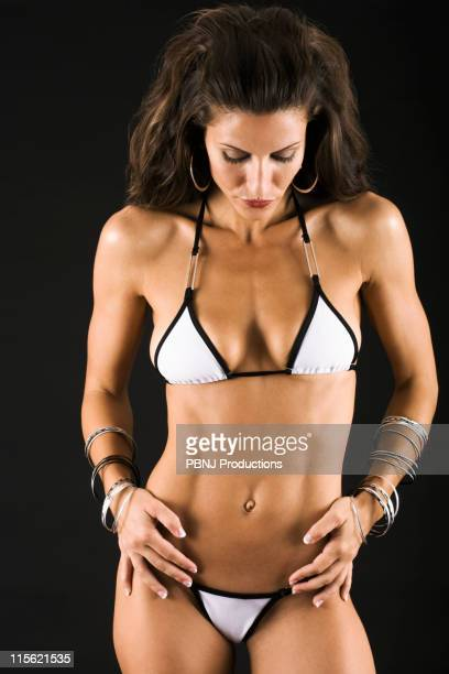 Hispanic female body builder in bikini
