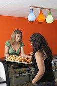 Hispanic female business owner in gourmet food store