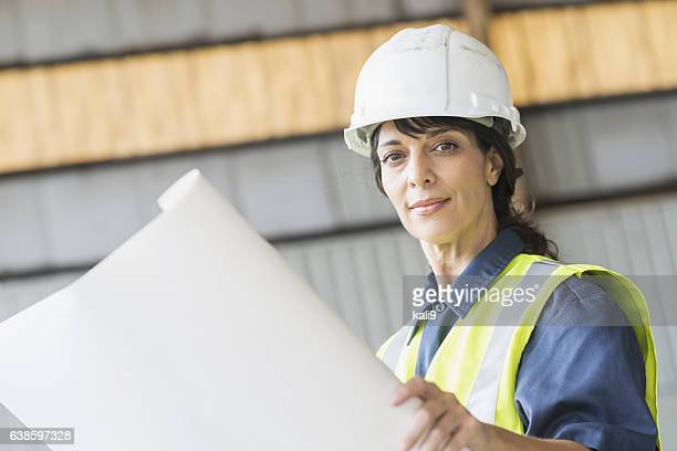 Hispanic, female construction worker