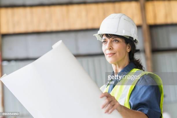 Hispanic, female construction worker
