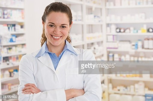 Hispanic female pharmacist smiling in pharmacy : Stock Photo