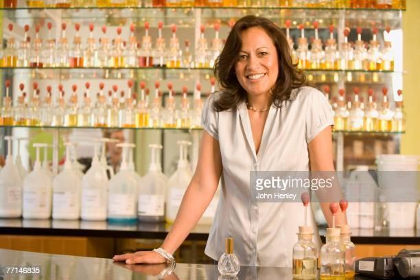 Hispanic female sales clerk at perfume store