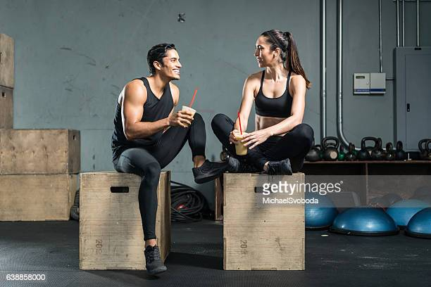 Hispanic Fitness Couple Drinking A Smoothie