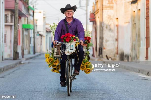 Hispanic florist riding bicycle