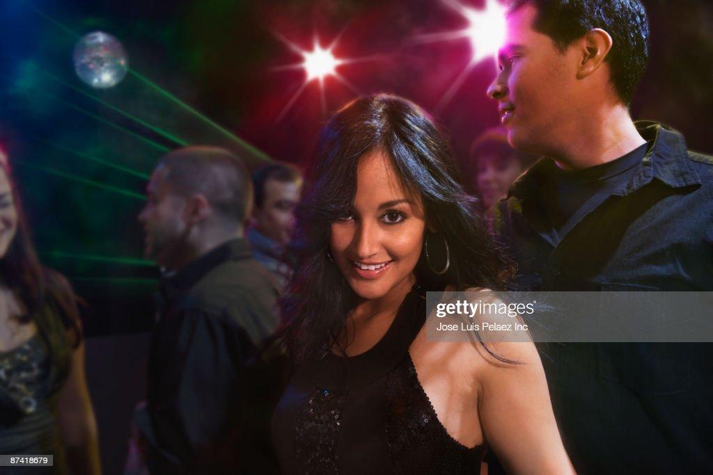 Hispanic friends dancing in nightclub : Stock Photo