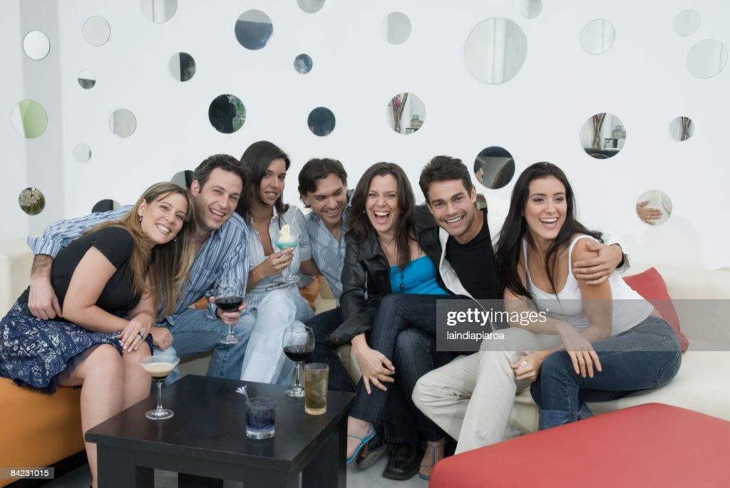 Hispanic friends drinking cocktails : Stock Photo