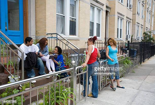 Hispanic friends on steps