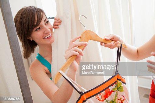 Hispanic friends shopping in clothing store : Stock Photo