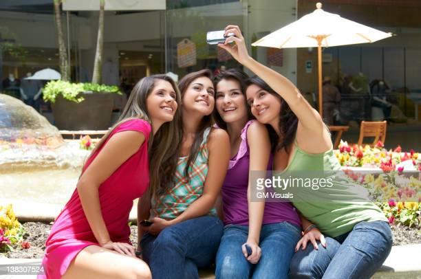 Hispanic friends taking self-portrait
