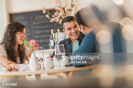 Hispanic friends talking in cafe