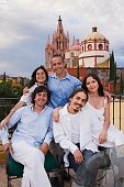 Hispanic friends with cathedral in background