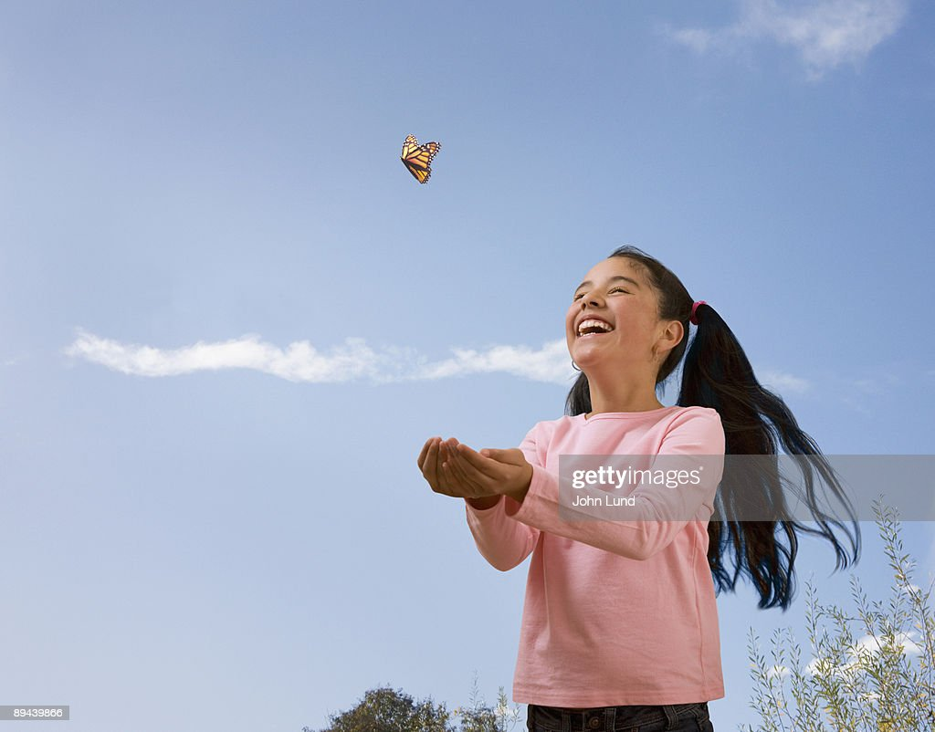 Hispanic Girl and Butterfly : Stock Photo