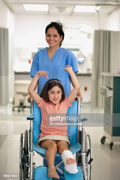 Hispanic girl cheering in wheelchair