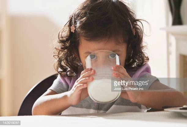 Hispanic girl drinking milk