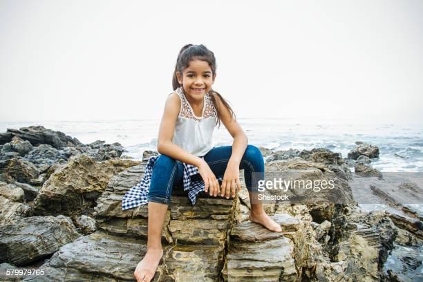 Hispanic girl exploring tide pools