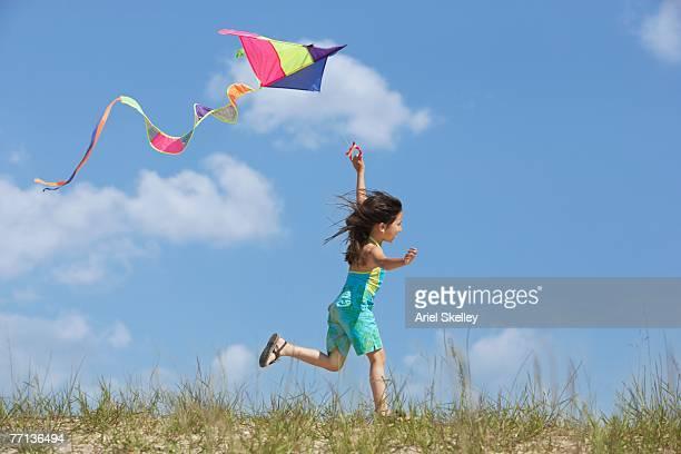 Hispanic girl flying kite