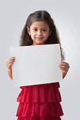 Hispanic girl holding blank card