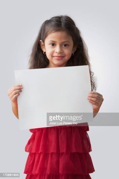 Hispanic girl holding blank card