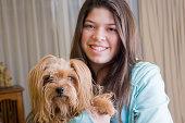 Hispanic girl holding dog