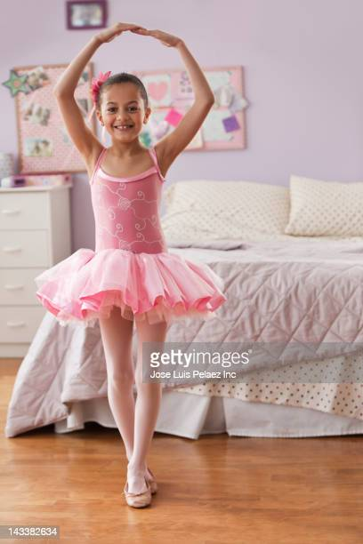 Hispanic girl in ballerina costume