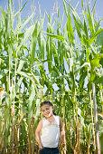 Hispanic girl in front of corn field